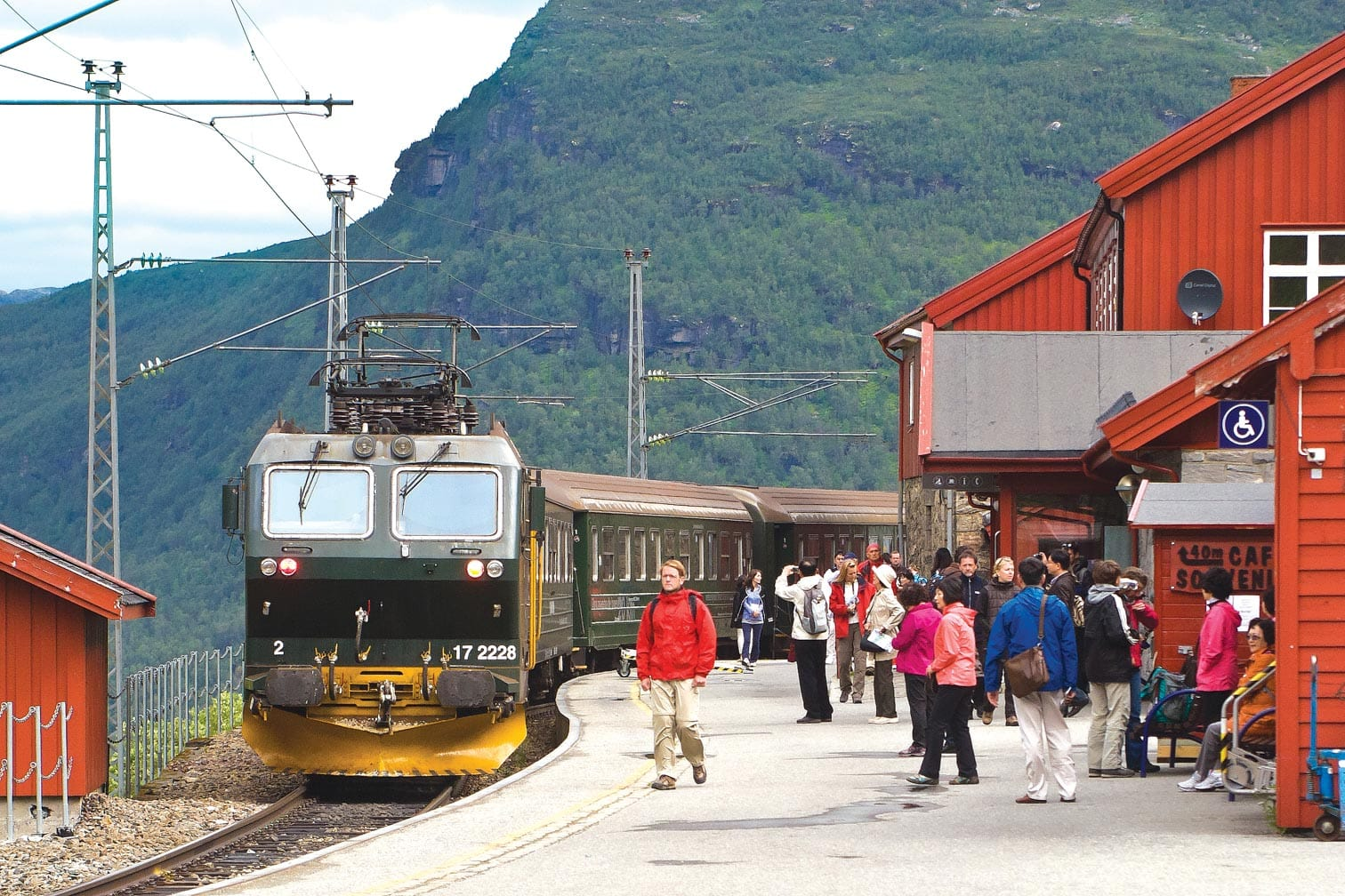 Flam Railway train stopping at a station