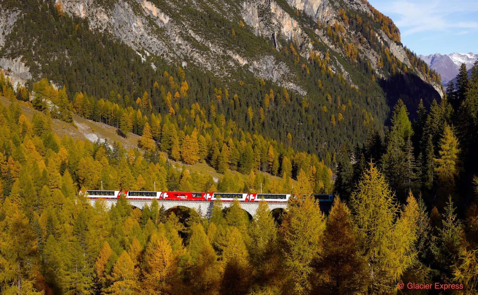 Glacier Express train going through mountains