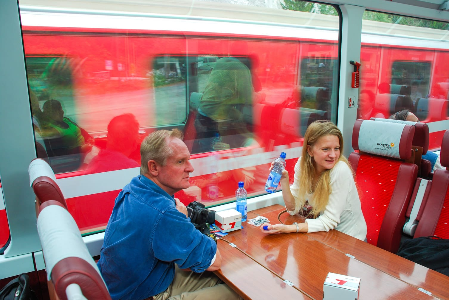Guests drinking water on the Glacier Express train
