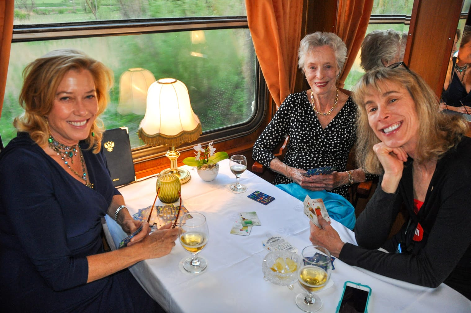 Three ladies sitting in the Golden Eagle Danube Express train