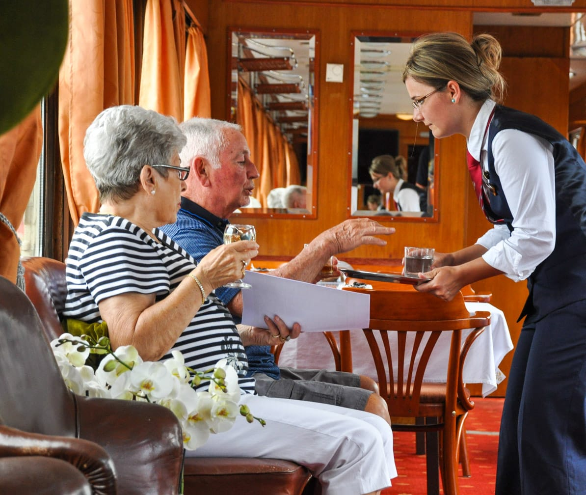 Serving guests on the Golden Eagle Danube Express train