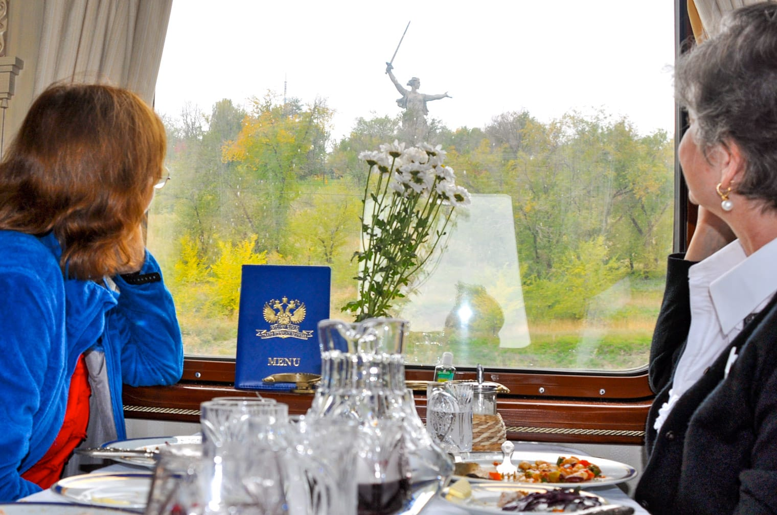 Two women looking out the window on the Golden Eagle train