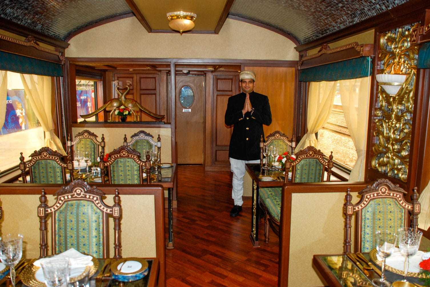 Service worker on the dining car on the Maharajas' Express train