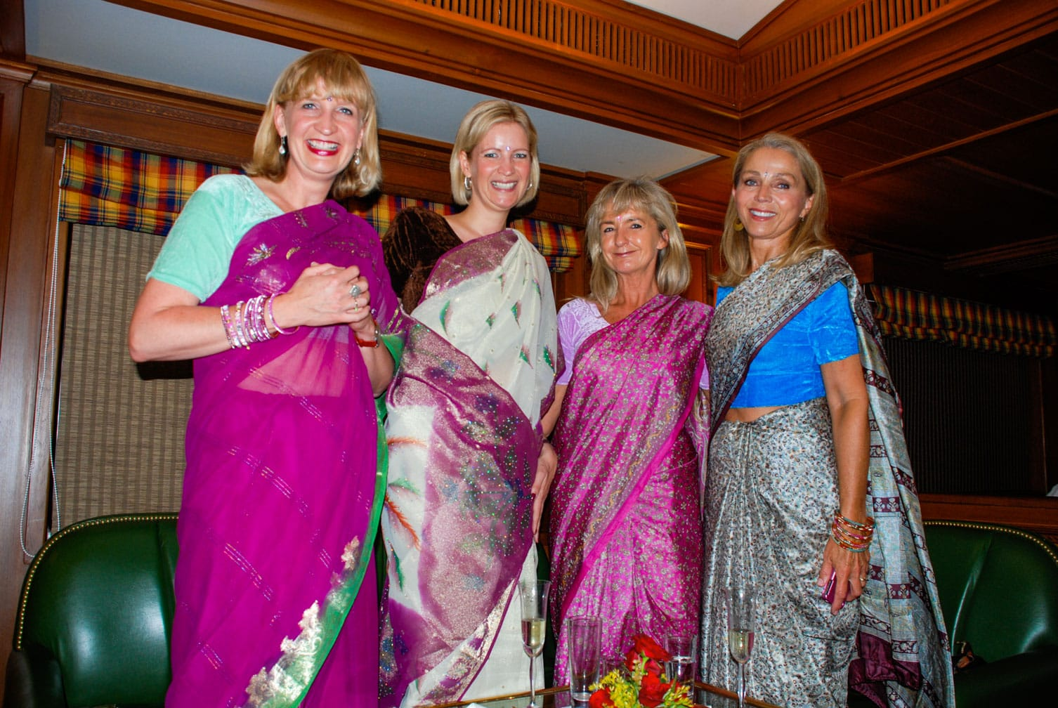 Four ladies dressed in saris on the Maharajas' Express train