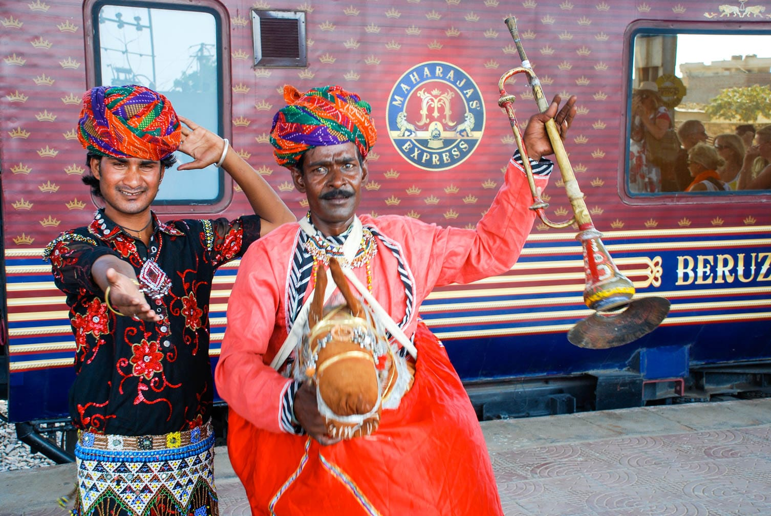 Two Indian dancers with instruments on the Maharajas' Express train