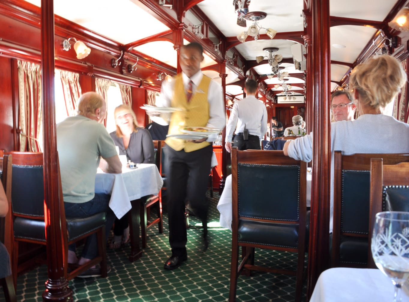 Server carrying food on the Rovos Rail Pride of Africa train