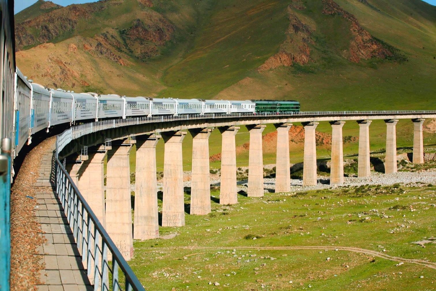 Exterior of the Shangri-La Express train on a bridge