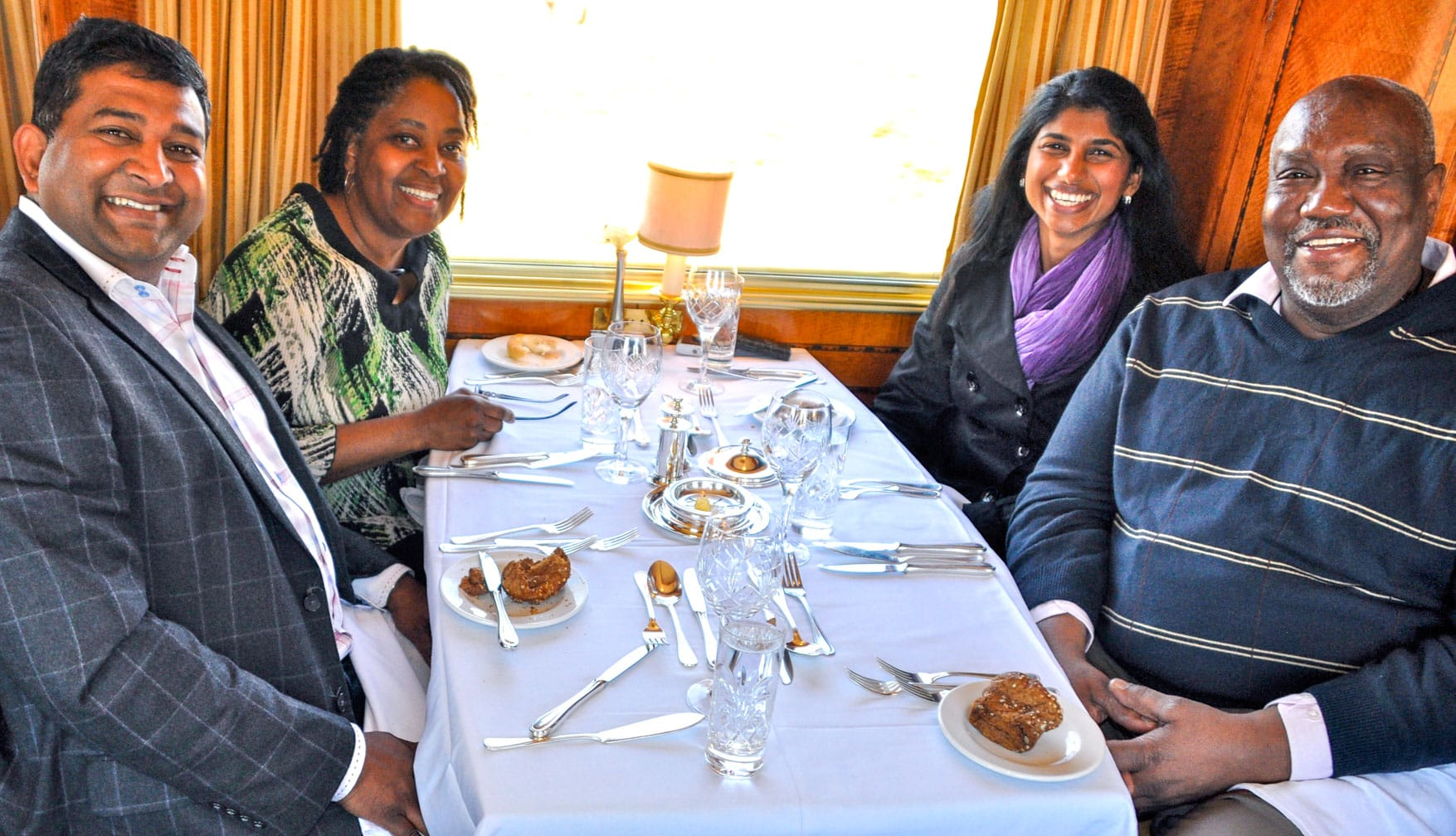 Friend sitting in the dining car of The Blue Train