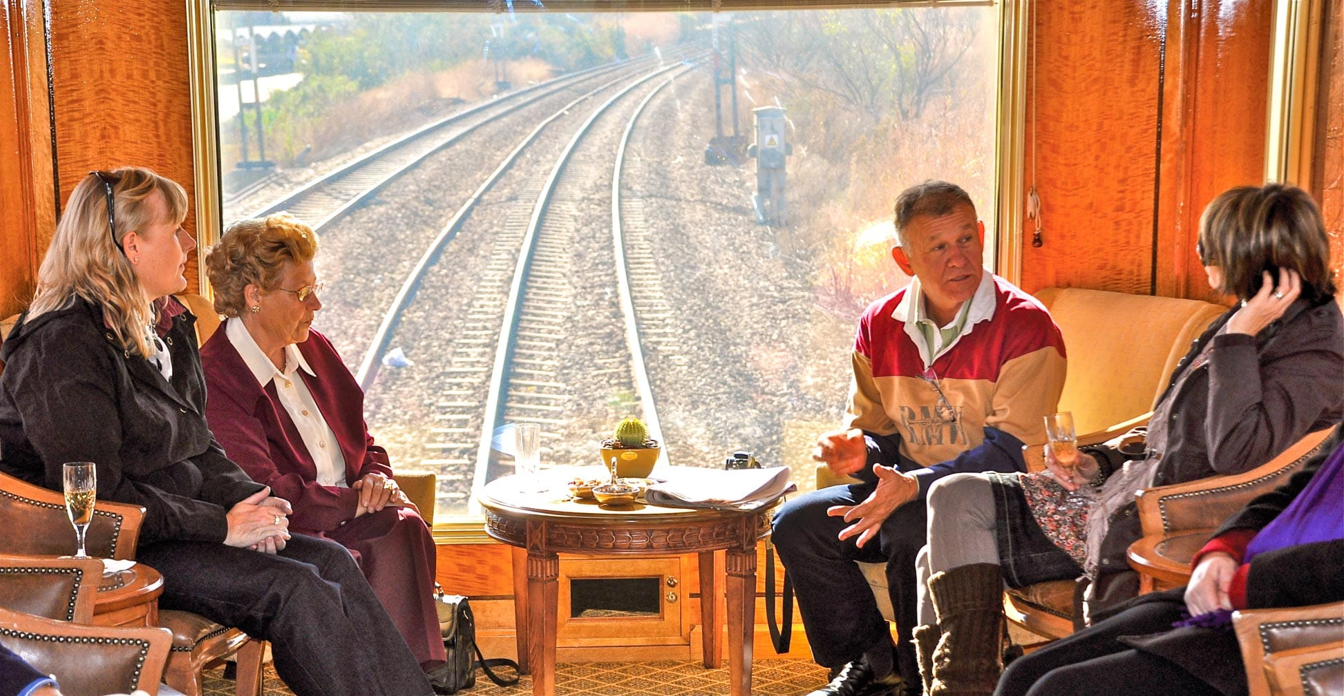 Guests relaxing in the observation car on The Blue Train