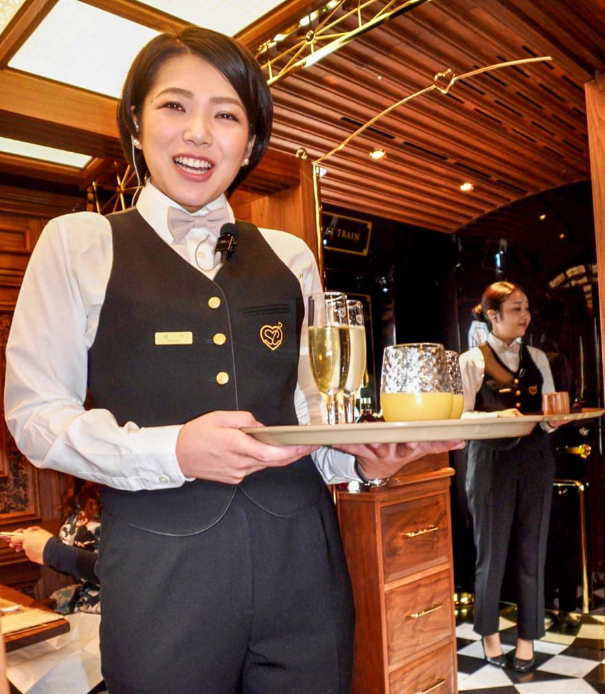 Server with drinks on The Sweet Train