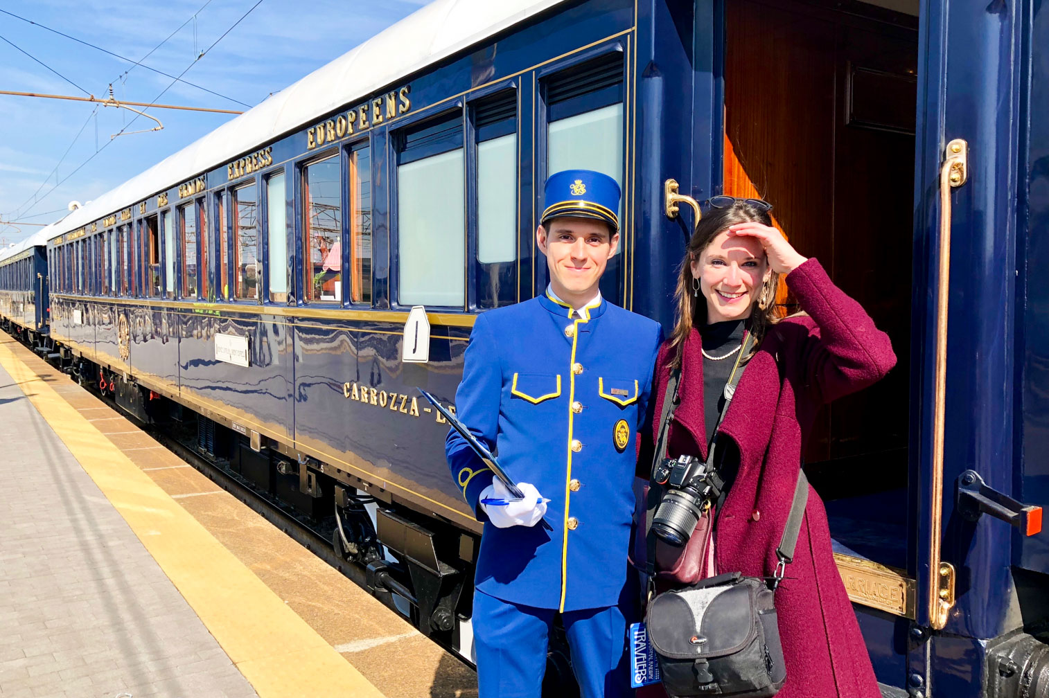 Staff and guest outside the Venice Simplon-Orient-Express (VSOE) train