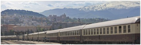 Al Andalus in Granada Station. The Alhambra is just visible on the hill behind the train.