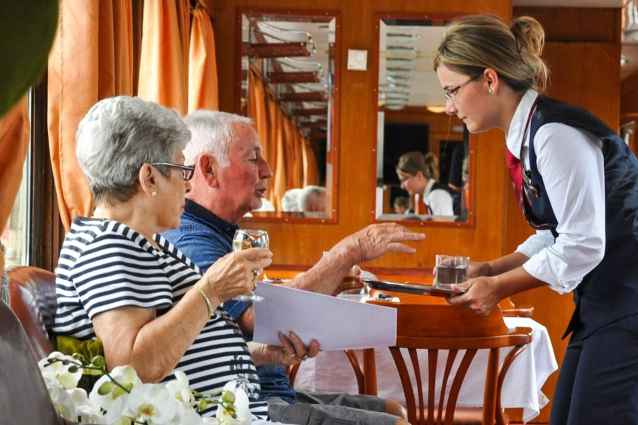 Guests enjoying the lounge car on the Golden Eagle Danube Express.