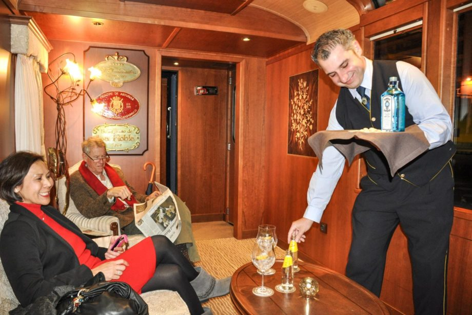Bartender serving drinks on the El Transcantábrico Gran Lujo train