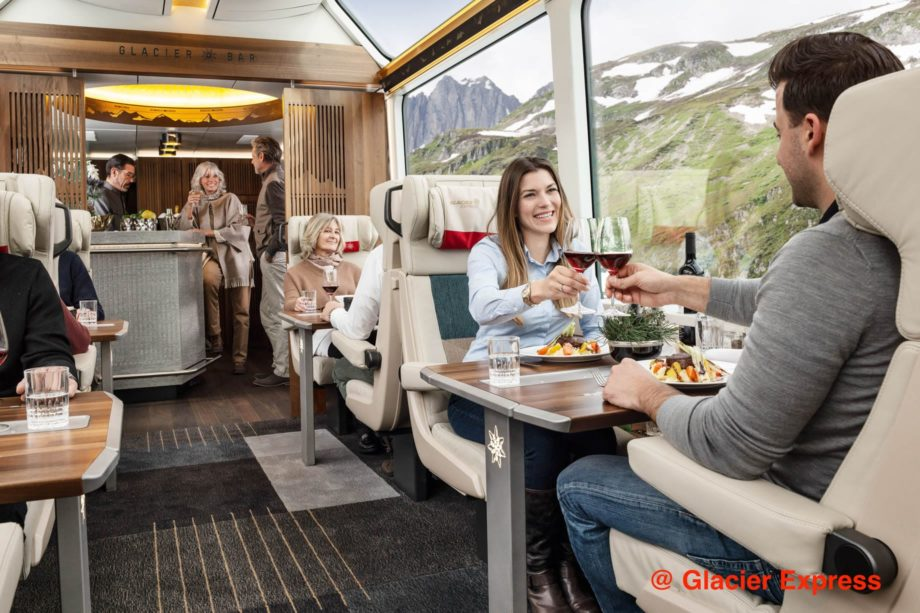 Guests drinking wine on the Glacier Express train