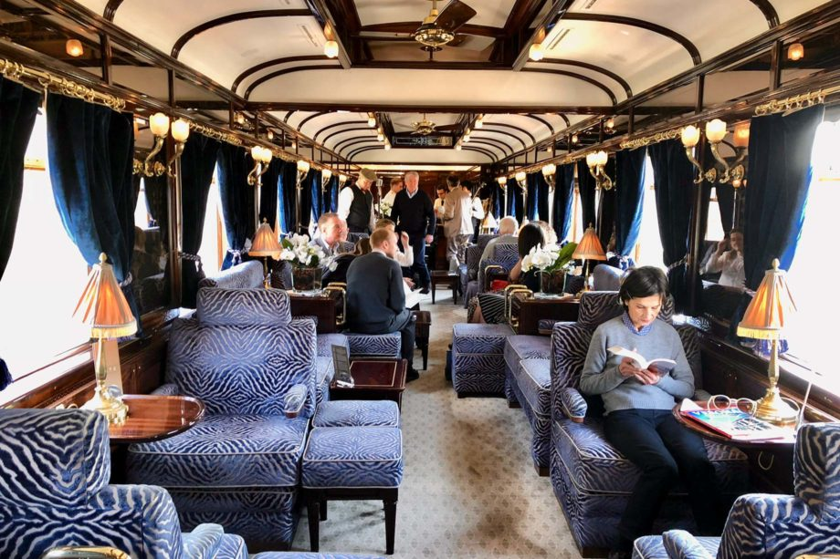 Guests reading in the Venice Simplon-Orient-Express (VSOE) train